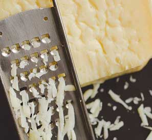 cheese being grated